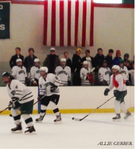 Fans crowd the bench as boys thirds hockey takes on girls JV.