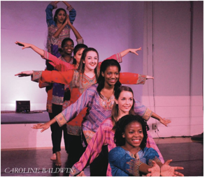 Dancers perform in the Bhangra piece.