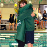 Smith and Hrabchak share an emotional moment at the team's Senior Meet on February 8.