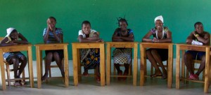 The girls of JBFC enjoy themselves in a classroom setting.