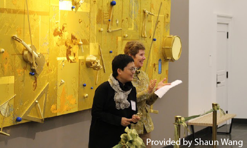 "Lin Tianmiao, P'15 presents her sculpture, ""The Golden Age,"" Dr. Curtis."