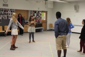 """Ms. Speed, an enthusiatic theater teacher, leading her class in the acting routine """"take the stage""""."""