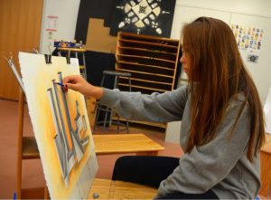 Working dligently on her untitled piece, Celine Kim '17 relishes the oppotunity for such creative exploration. Credit: Olivia Jones