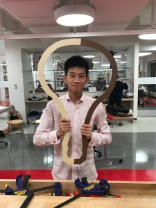 Xander Li '17 poses with an iLab creation. Credit: The Daily Bulletin